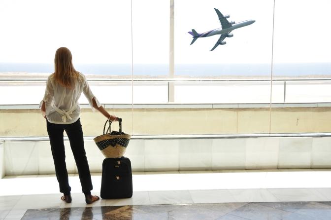 bigstock-girl-at-the-airport-window-loo-26611490.jpg